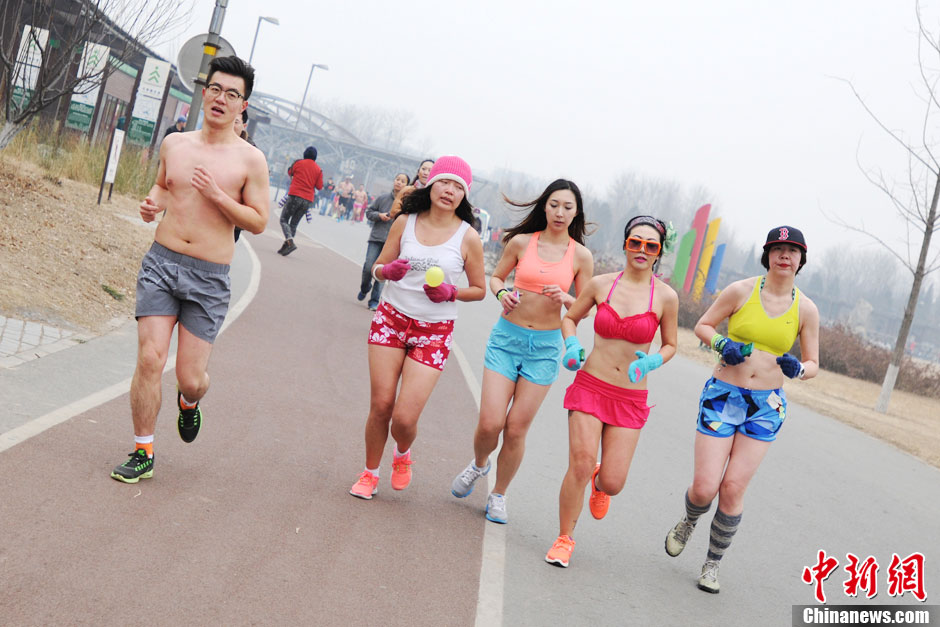 People in underwear participate in a long distance run to promote